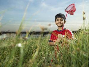 Image of a boy holding a butterfly net